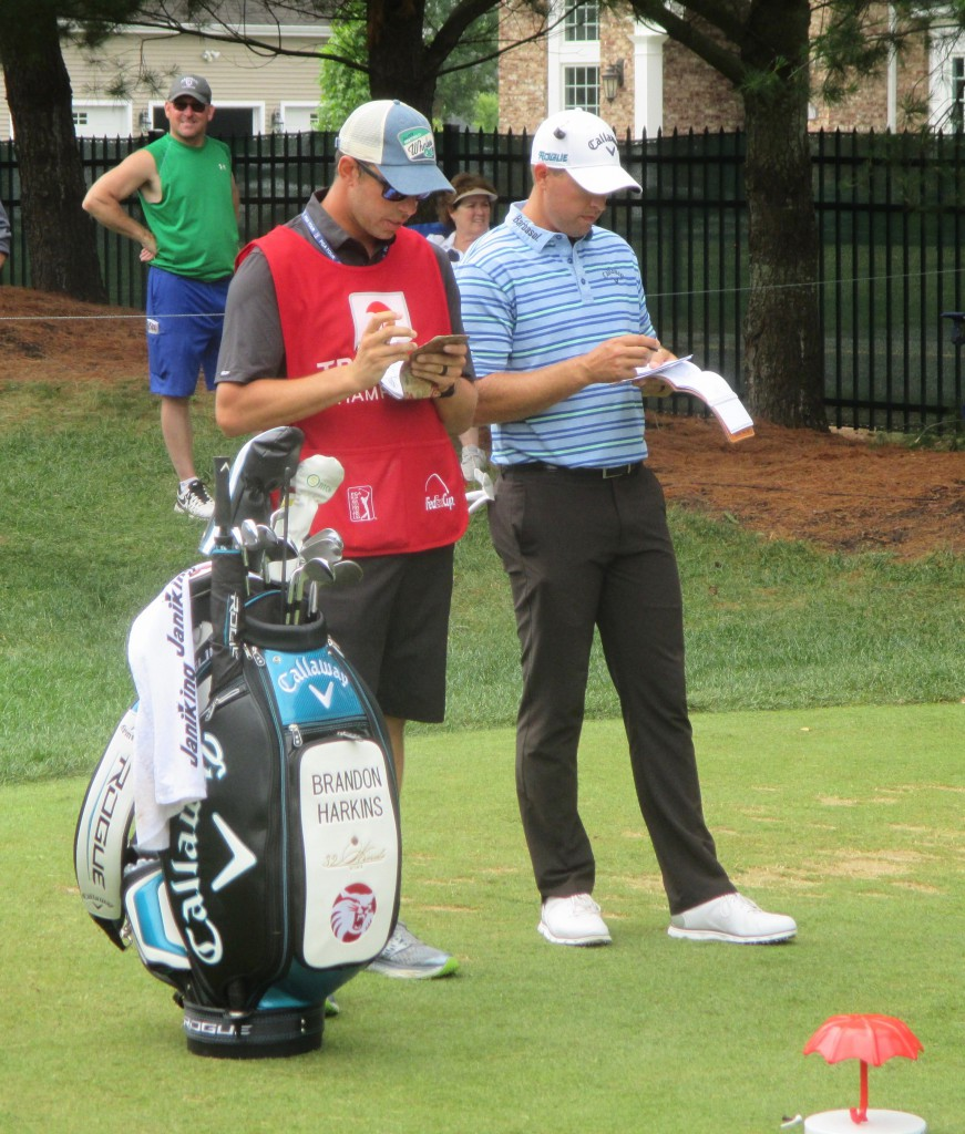 Tim Guiliano, left, and Barndon Harkin go over the numbers on the ninth tee of TPC River Highlands during the 2018 Travelers Championship.