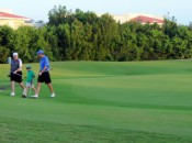 A family threesome leaves the final green on the Lakes 9 at the Moon Spa & Golf Club