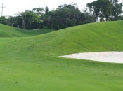 Artifice: Playing the blind third shot at Playa Paraiso's 18th hole