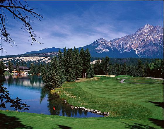 Players must skirt the crystal blue waters of Lac Beauvert on their approach to the sixteenth at Jasper Park Golf Club.