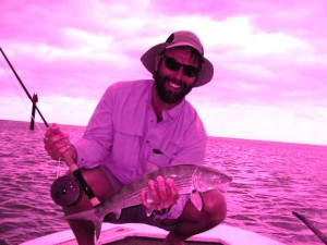 The author poses with a very average size bonefish from the flats around Andros Island.