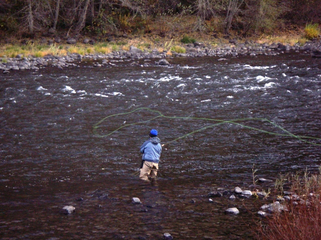 An angler on Oregon's Grande Ronde River unleashes a long cast with a spey rod.
