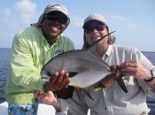 Guide Michael Anderson and angler Geoff Roach proudly display Geoff's first permit, landed at Turneffe Atoll.