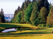 The fifth at Capilano.  Off the tee, part of the Vancouver skyline is visible through the pines.