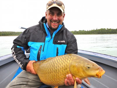 Kirk Deeter holds a fine carp landed on the fly.
