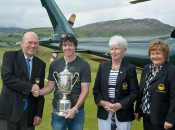 A relaxed Rory McIlroy, with U.S. Open hardware close at hand, is greeted by club officers at Ballyliffin GC.