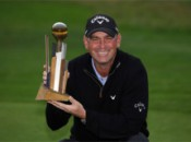 Why is this man smiling?  He doesn't have to play the 18th again!