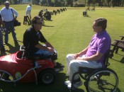 Dr. Michael Jacuch, right, learning about the benefits of the ParaGolfer from Jerry Donovan.