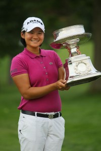 Yani Tseng with one of the 12 trophies she collected in 2011. Photo copyright Icon SMI.