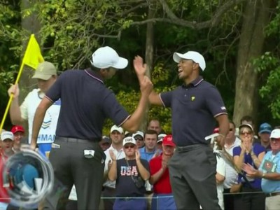 Tiger Woods (r.) and Matt Kuchar high-five each other during Thursday's four-ball match at the Presidents Cup (Photo: Andy Lyons/Getty Images)