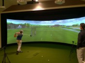 Manchester CC head golf professional Todd McKittrick watches a member take his hacks on on MCC's aboutGolf SimSurround Curve golf simulator (Photo: Gil Talbot Photography)