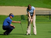 Golf professional giving a putting  lesson