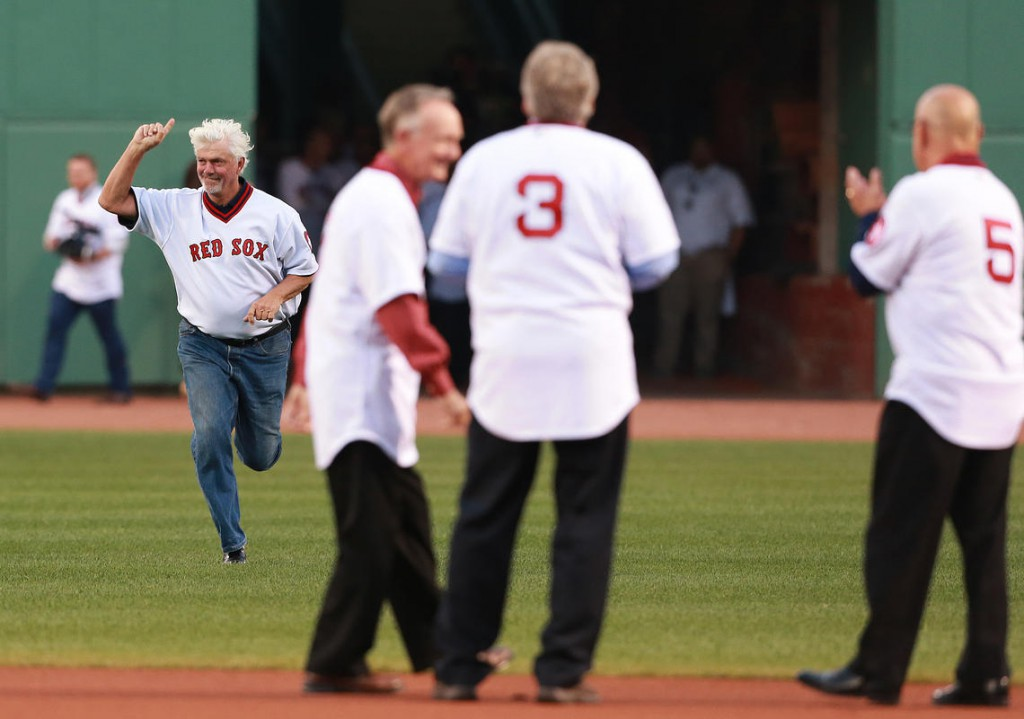 Bill Lee trots in from centerfield during a 40th anniversary celebration of the 1975 Sox, at Fenway Park.