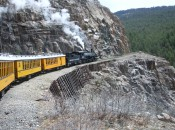 The Durango-Silverton train chugs along on sheer faces above the Animas River