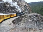 The Durango-Silverton train chugs along on sheer faces above the Animas River