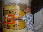 Milwaukeean Rick Hart, a fan of brewers and Brewers, hugs the mug from the old Bernie Brewer Chalet, which found a new home at Lakefront Brewery after County Stadium was torn down.