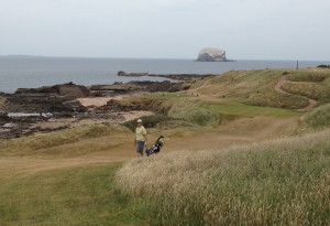 No. 14 at the Glen Golf Club, with 13th green and Bass Rock in background.