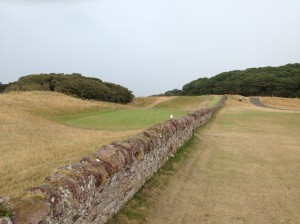 Carry the stonewall that guards the 13th green at North Berwick's West Links--or scuff your ball.