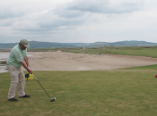 First tee at Machrihanish. Take it over the beach.