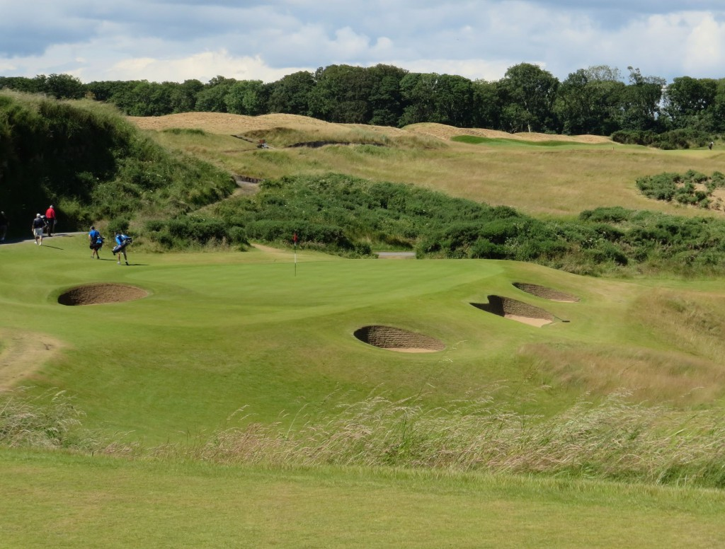 The 13th, a one-shotter guarded by a valley, bunkers and gorse.