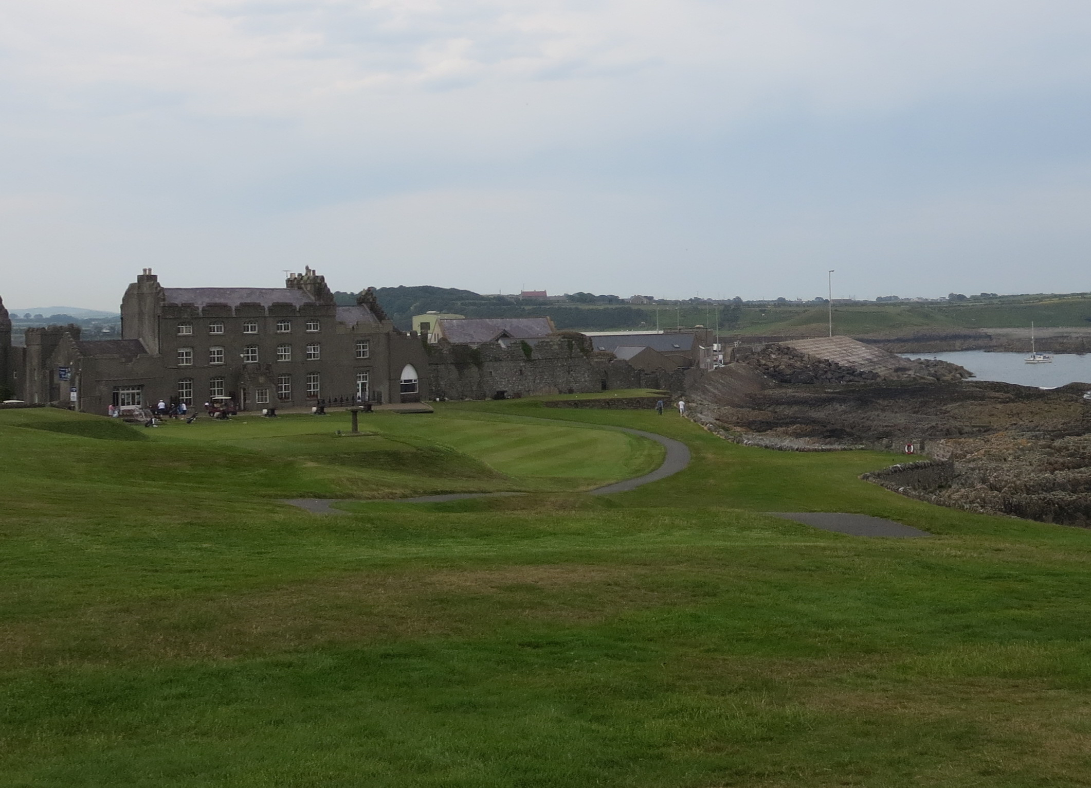 Ardglass' daunting first tee lies to the right of its ancient clubhouse. The first  green and 18th tee sit on the hill above the first and final fairways.