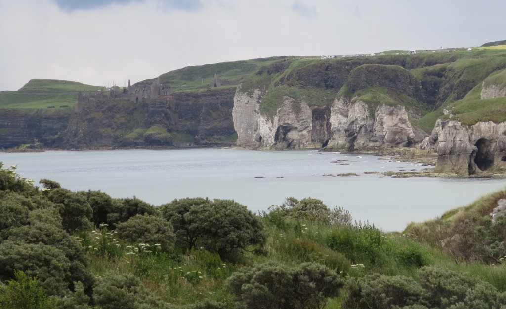The white cliffs, right, and the Dunluce Castle, left, provide the view from the far side of Royal Portrush .