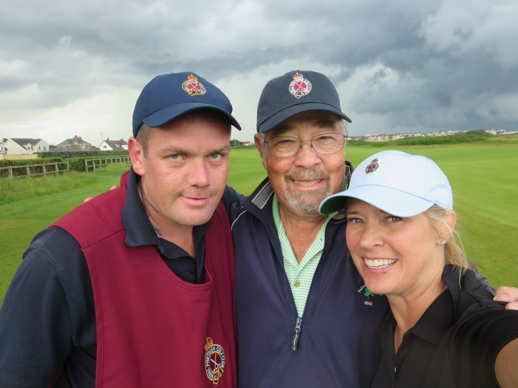 Liz and I and our caddie/driver, Paul, grab a quick selfie before the heavens erupt.