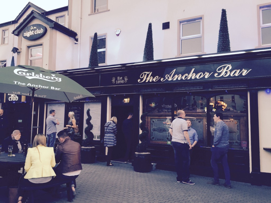 The Anchor Bar is a popular Portstewart gathering place outside. . .