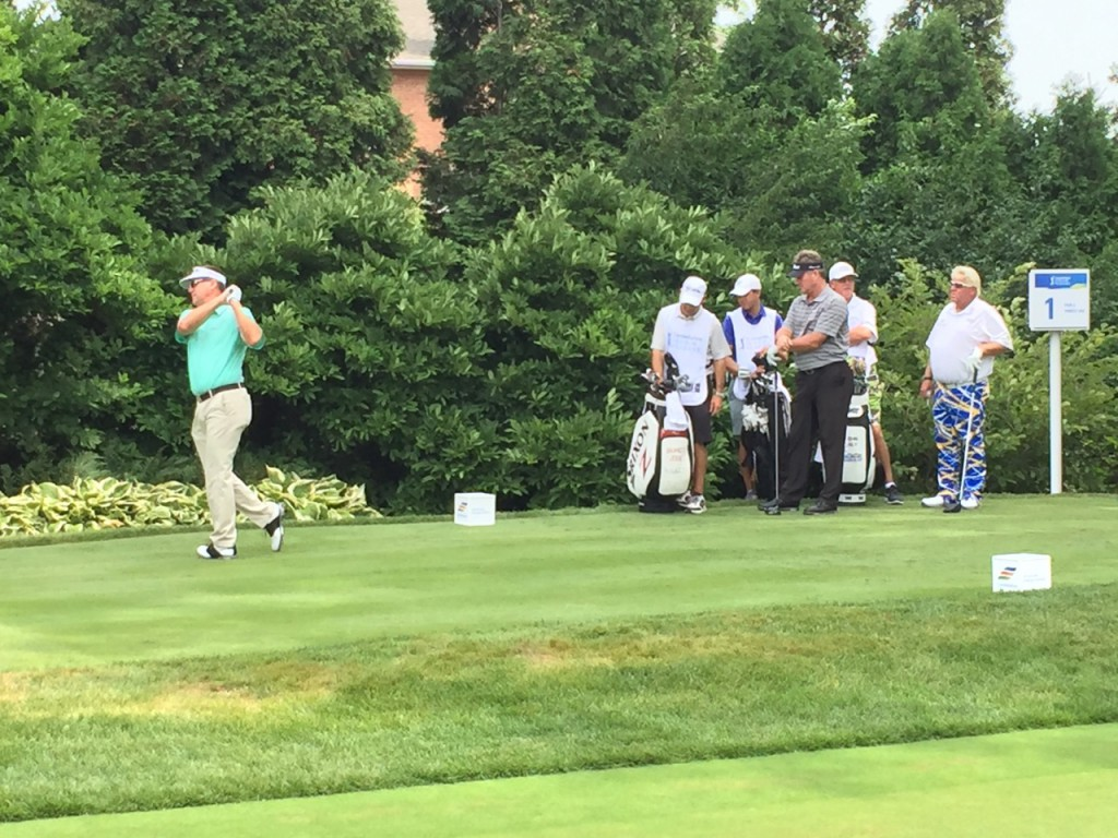 John Daly (right) and Todd Hamilton watch as Brandt Jobe tees off at Senior Players Championship.
