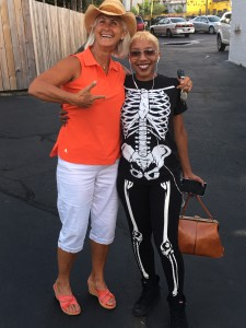 The author, wearing Antigua Trust sleeveless shirt having fun with her skeleton friend.