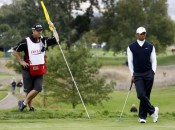 Tiger Woods and his new caddie Joe LaCavaon one the second green of the Frys.com Open.  AP Photo by Dino Voumas