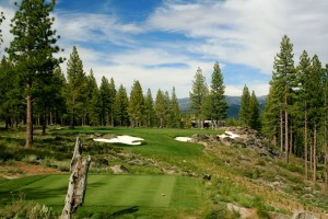 The par 3 17th hole at Martis Camp is a small target, well-guarded by bunkers and a rock outcropping.