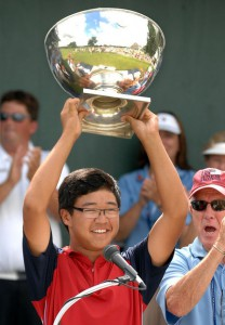 14-year old Jim Liu holds his first-place U.S. Junior Amateur trophy over his head after 2010 victory.  Photo by Paul L. Newby,II, of The Grand Rapids Press.