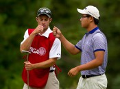 Caddie Eric Hedspeth and Jim Liu fist-bump in the first round of match play, only to hit bigger bumps in round two.