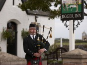A piper plays outside The Jigger Inn