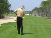 "El Cameleon's designer, Greg Norman, ""The Great White Shark,"" shows how you hit a ball so it hurts, during the course grand opening about five years ago."