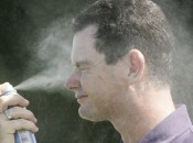 Golf Pro Rory Sabbatini applying sun protection.