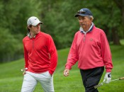 Rory McIlroy (l) walks with Craig Harmon at Oak Hill during Media Day.