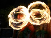 Twirling fire batons