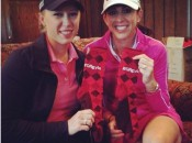 Morgan Pressel (l) and Nicole Castrale display the GRgyle socks