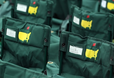 Augusta National members are accorded seat service at  the 18th green