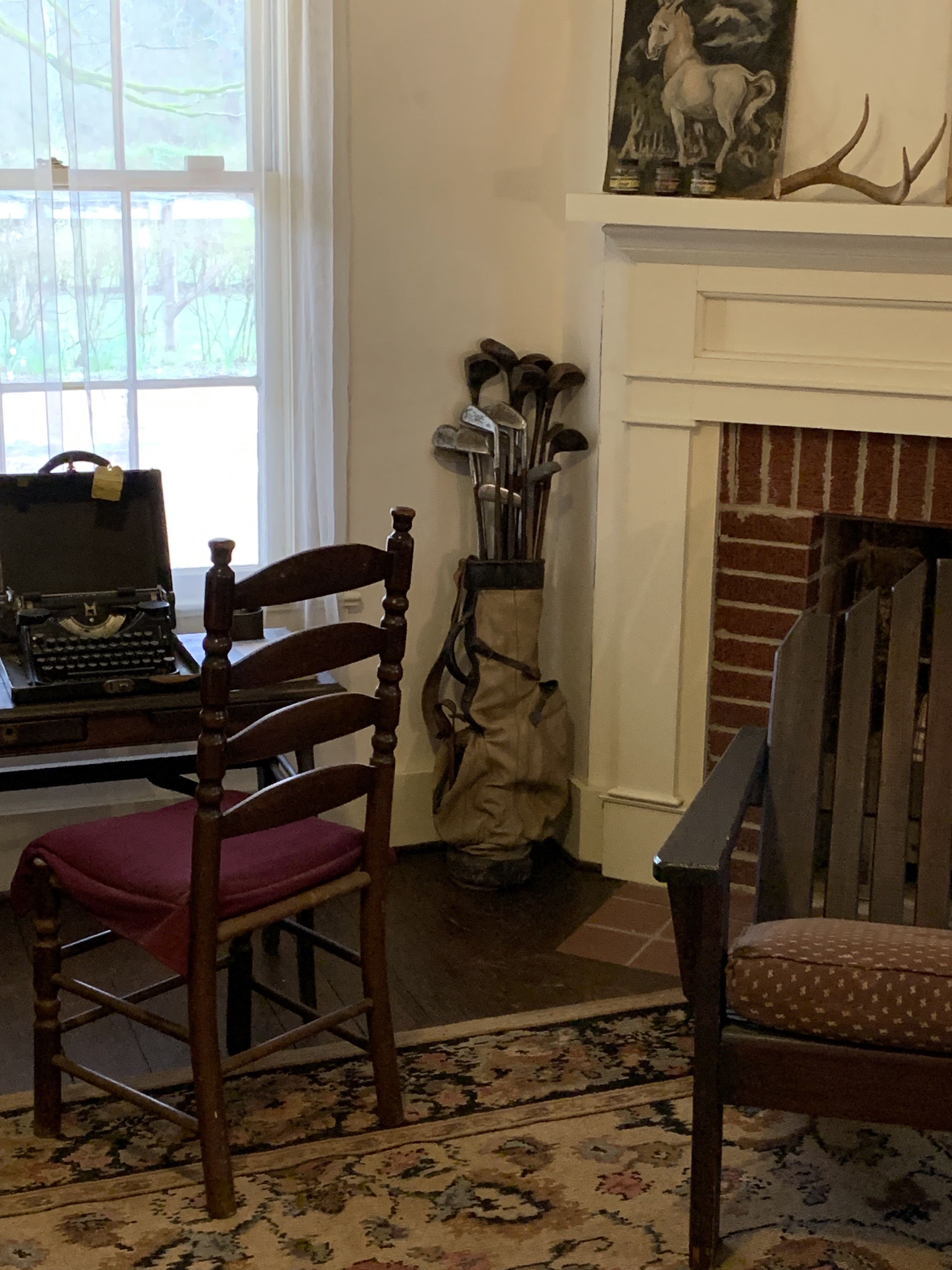 Next to his typewriter, Faulkner's golf clubs
