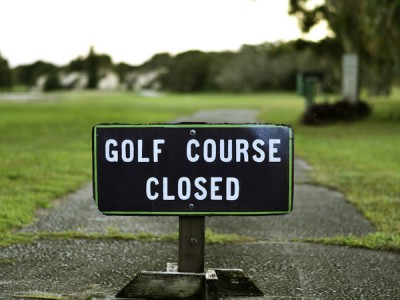 Golf Course Closed Sign on Street