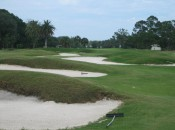 The drive at the short 16th must either fly or flank these bunkers.