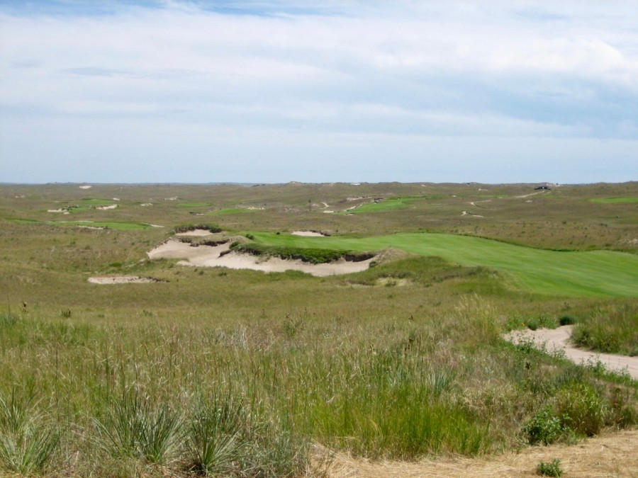 Views like this of one of the world's greatest and most original golf sites--this is from the par-5 16th tee--are common throughout the round at Sand Hills.