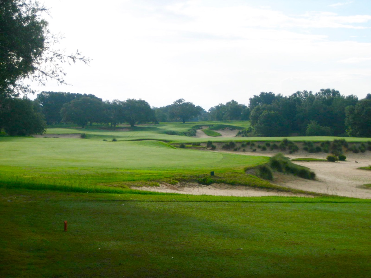 Things get real at Pine Barren's par-5 4th with a safe-option drive to a big left fairway or a high risk play over the sand cavern to a short fairway on the right.