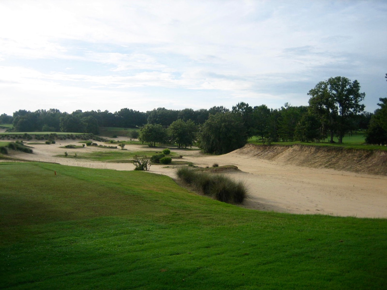 The sand cavern to the right of the 4th hole was made by simply digging into the forested soil that existed naturally on site.