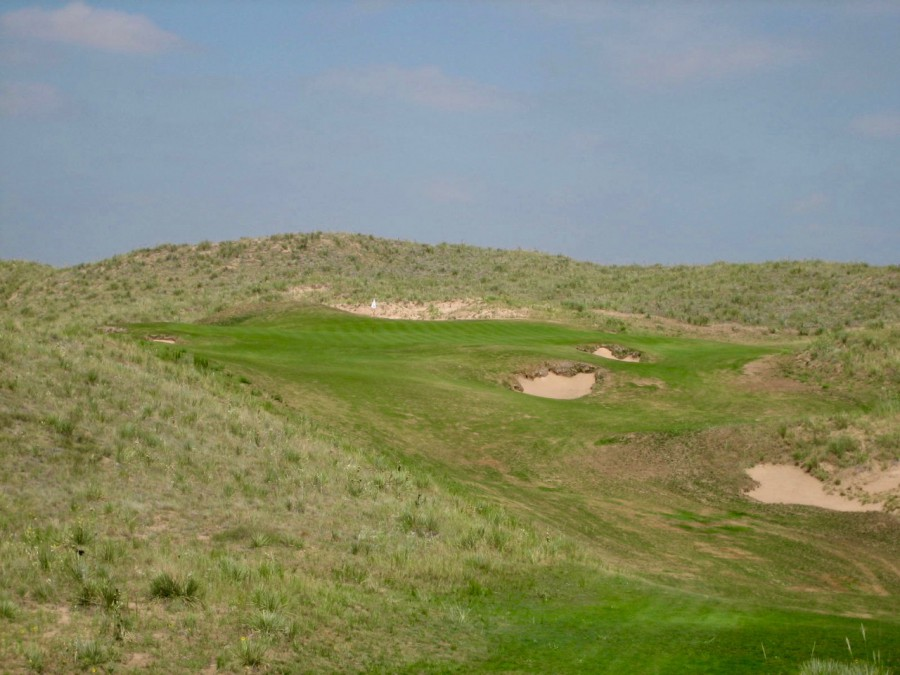 Peak to peak: the par-3 11th plays from an elevated dune across a valley to a big green cut into another elevated dune.