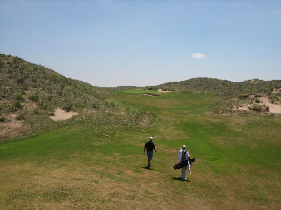 Into the Chop Hills. The par-3 15th gives a sense of the size and scale of the Ballyneal landscape.