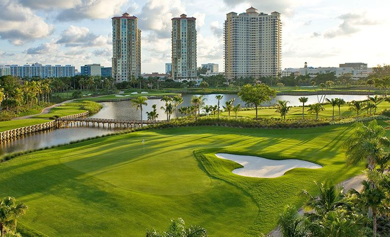 The Soffer Course's 16th and 17th holes are framed by water and the surrounding towers.